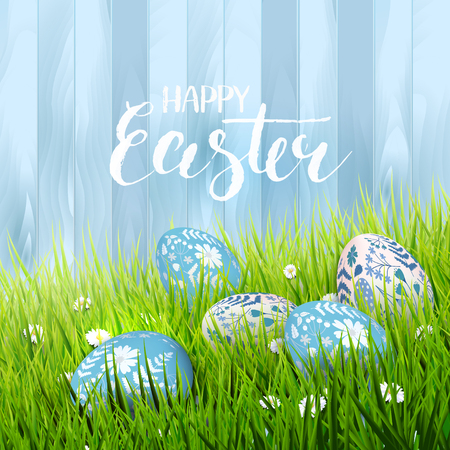 Happy Easter greeting card with eggs lying in the grass. Brush lettering 向量圖像