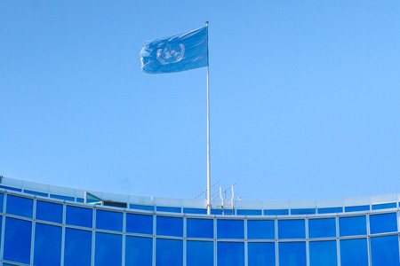new world order: GENEVA, SWITZERLAND - JUNE 6, 2016: . The United Nations flag at the building in Geneva, Switzerland