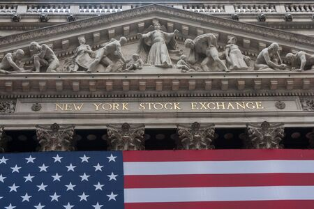 nyse: Wall street New York Stock Exchange with American flag