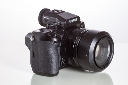 megapixel: Fujifilm GFX 50S, 51 megapixels, medium format sensor digital camera with 63 mm G-mount lens on white reflecting background Editorial