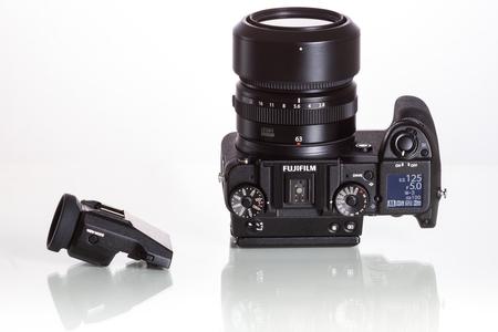 Fujifilm GFX 50S, 51 megapixels, medium format sensor digital camera with additional electronic viewfinder 3.69M-Dot OLED EVF on white reflecting background Editorial