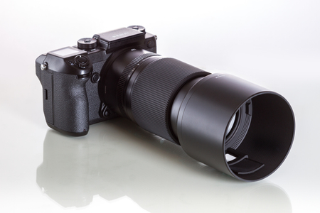 Fujifilm GFX 50S, 51 megapixels, medium format sensor digital camera on white reflecting background with 100 mm G-mount lens Editorial