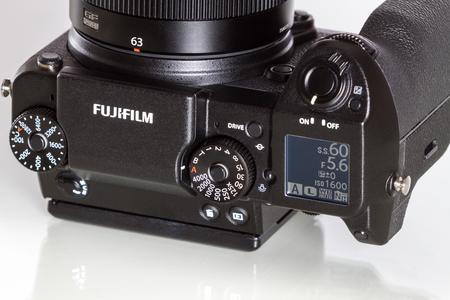 megapixel: Fujifilm GFX 50S, 51 megapixels, medium format sensor digital camera on white reflecting background