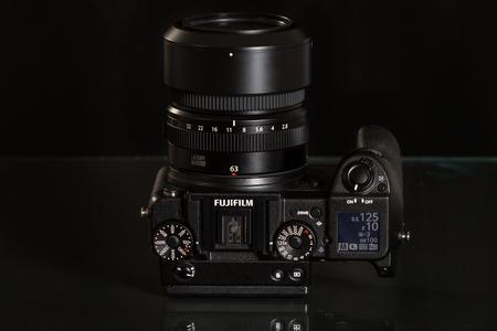 megapixel: Fujifilm GFX 50S, 51 megapixels, medium format sensor digital camera on black reflecting background