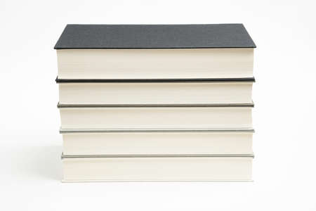 A set of five neatly stacked and arranged monochromatic cloth bound books on a plain white background. Imagens