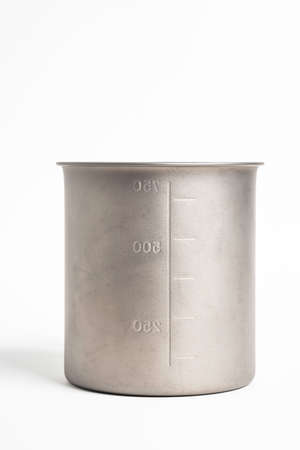 An all-metal multiple purpose mug with flexible handle and measuring mark set on a plain white background.