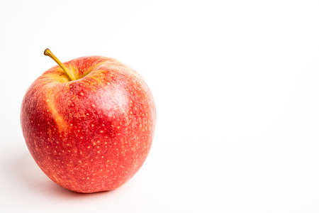 One fresh red apple isolated on a plain white background. Foto de archivo