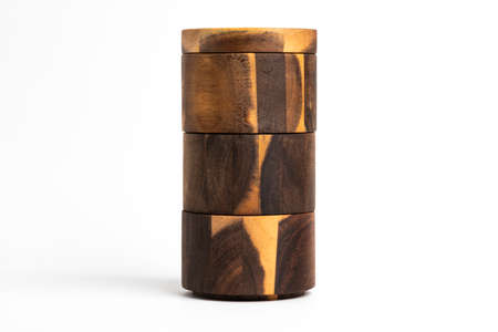 A towering three-level set of bamboo wood condiments vessel with lid cover set on a plain white background.
