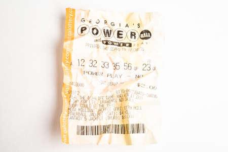 Vidalia, Georgia / USA - September 9, 2019: A close-up studio shot of the crumpled Georgia Powerball yellow lottery printout ticket. Editorial