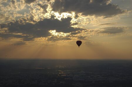 Balloon in sunset sky