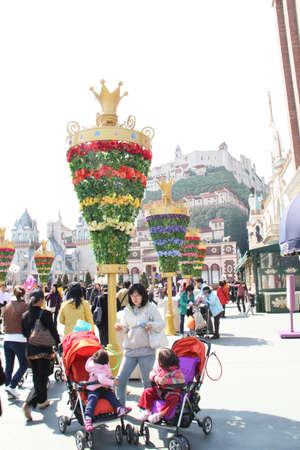 EVERLAND, YONGIN, KOREA - APRIL 06 : The unidentified group of tourists are queuing and be happy at the entrance way on april  06, 2011 at Everland, Yongin, Korea.