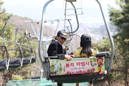 EVERLAND, YONGIN, KOREA - APRIL 06 : The unidentified tourists are travelling and enjoy Cable car is sitting   on april 06, 2011 at Everland, Yongin, Korea. Editorial
