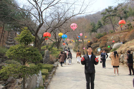 WAUJEONGSA TEMPLE,SUWON,KOREA-APRIL 06 :The unidentified tourists are travelling and Temple to see the beauty of the economic treatment of the large and worship God. on april 06, 2011 at waujeongsa temple, suwon, Korea.  Editorial
