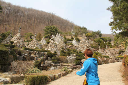 WAUJEONGSA TEMPLE,SUWON,KOREA-APRIL 06:The unidentified tourists are travelling and Temple to see the beauty of the economic treatment of the large and worship God. on april 06, 2011 at waujeongsa temple, suwon, Korea.  Editorial