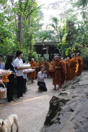 Sakon Nakhon,Thailand - October 30,2011 : Buddhist monks walk collecting alms in the morning on Kathin tradition.  on october 30, 2011 in sakon nakhon, Thailand. Editorial