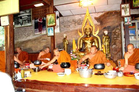 Sakol Nakhon,Thailand -October 30, 2011 -  Unidentified thai  monks eating Lunch in  The Kathin. Sakon Nakhon Thailand October 30,2011 Stock Photo - 11887356