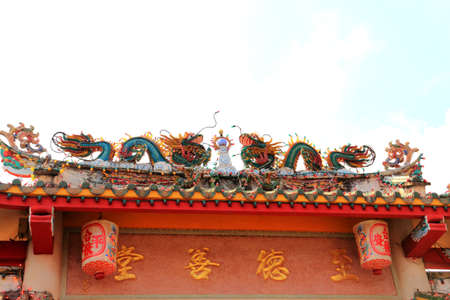 Two dargon scluptures on temple roof. Stock Photo