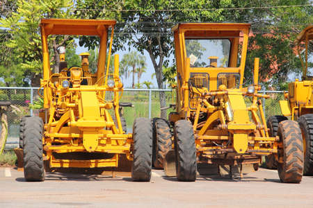 Stock image of motor grader working on road construction Stock Photo