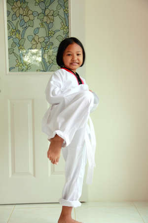 Little girl practice karate ,Taekwondo  photo