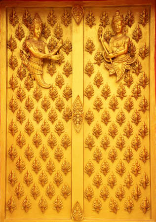 Buddhist decoration on a door in a temple photo