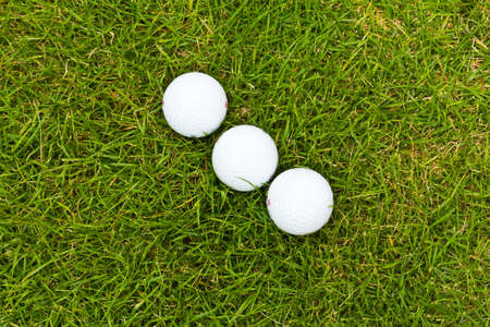 golf ball on sports golf course and hole