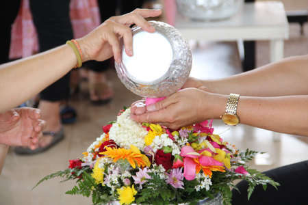 Thai people celebrate Songkran  new year   water festival  13 April  by giving garlands to their seniors and asked for blessings  Stock Photo