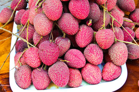 Closeup of freshly produced bunch of ripe and  Lychee fruits