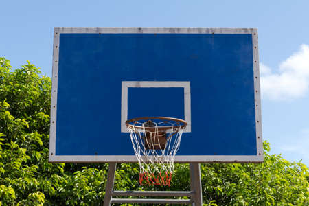 Basketball goal net on blue sky photo