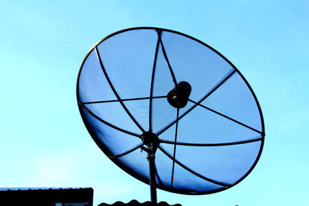 Satellite dish in morning sky photo