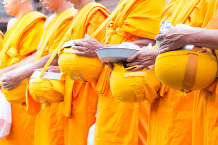 Give Food Offerings To a Buddhist Monk Of Thailand