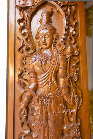 art buddha on the wood door in temple Stock Photo