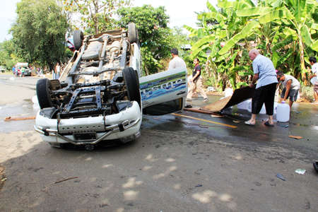 overturned overturn: PHETCHABUN, THAILAND - NOVEMBER 24 : Car accident on the road with turned upside-down after road collision november 24,2012 in phetchabun thailand. Editorial