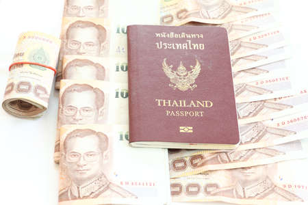 Thailand passport and Thai money on white background  photo