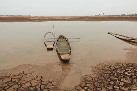 old wooden deserted boat on the ground due to river dried up  drought