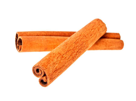 cannelle: Cinnamon sticks on a white background