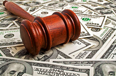 Wooden gavel and American dollars