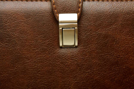 business case: Close-up of lock on leather business case