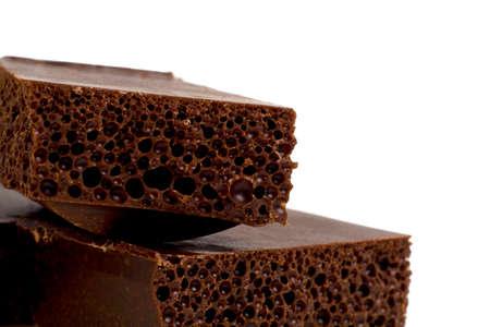 porous: Porous dark chocolate, close-up