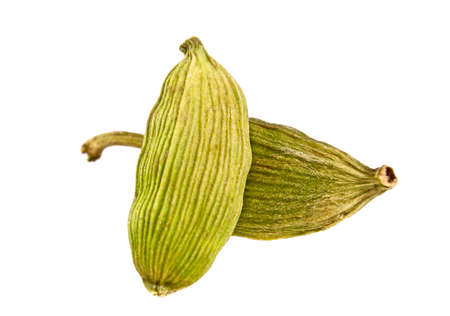 Close up of cardamon pods on white background