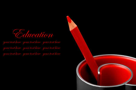 red pencil: Red pencil on black background
