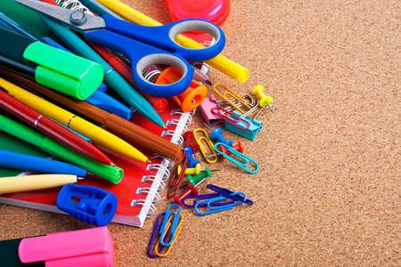 teaching material: School supplies on a cork board