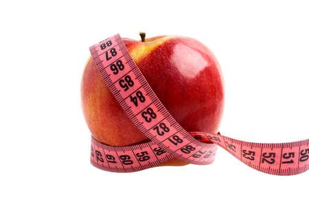 concept de régime - pomme rouge et un ruban à mesurer