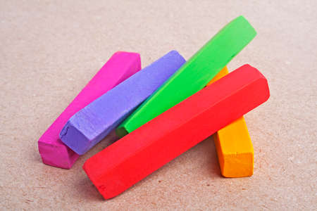 Colorful chalk pastels on color paper background Stock Photo