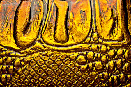 satined: Golden alligator patterned background Stock Photo