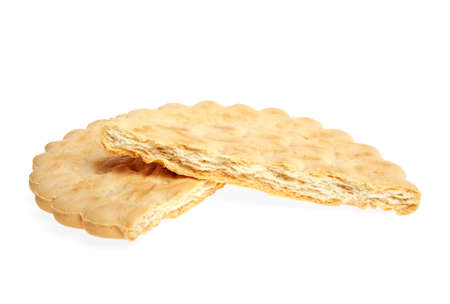 two and a half: Two half of broken butter biscuits on a white background