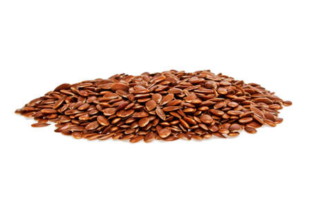 common flax: Heap of brown flax seed or linseed isolated on white background