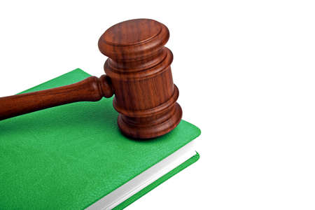 judicial proceeding: Wooden mallet and book on a white background