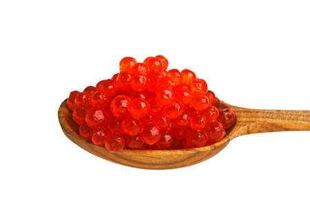 brown trout: Red caviar with wooden spoon on white background