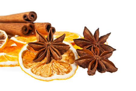 Christmas decoration - orange, cinnamon and anise on a white background