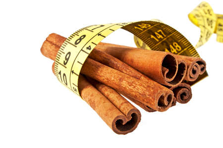 cinnamon sticks: Cinnamon sticks wrapped roulette on a white background Stock Photo